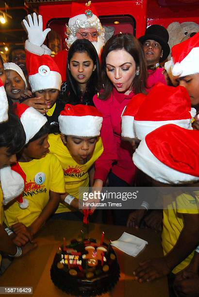 Nita Ambani Chairperson of Reliance Foundation with her daughter Isha and the special Kids of Drishti Akansha during the Christmas celebration at...