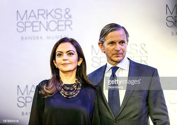 Nita Ambani the wife of Mukesh Ambani the Indian billionaire and chairman of Reliance Industries Ltd left stands with Marc Bolland chief executive...