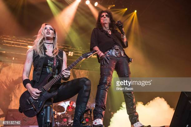 Nita Strauss and Alice Cooper perform at Wembley Arena on November 16 2017 in London England