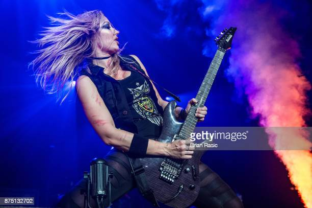 Nita Strauss of Alice Cooper band performs at Wembley Arena on November 16 2017 in London England