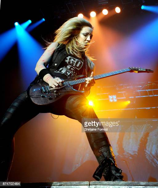 Nita Strauss performs with Alice Cooper live on stage at Manchester Arena on November 15 2017 in Manchester England
