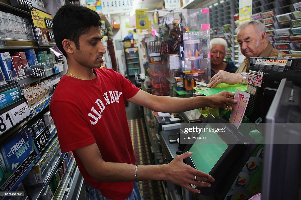 Nitesh Phel sells Powerball tickets at Circle News Stand on November 28, 2012 in Hollywood, Florida. The jackpot for Wednesday's Powerball drawing is currently at $550 million which is the richest Powerball pot ever. It is likely to rise even more as people continue to buy before tonights drawing.
