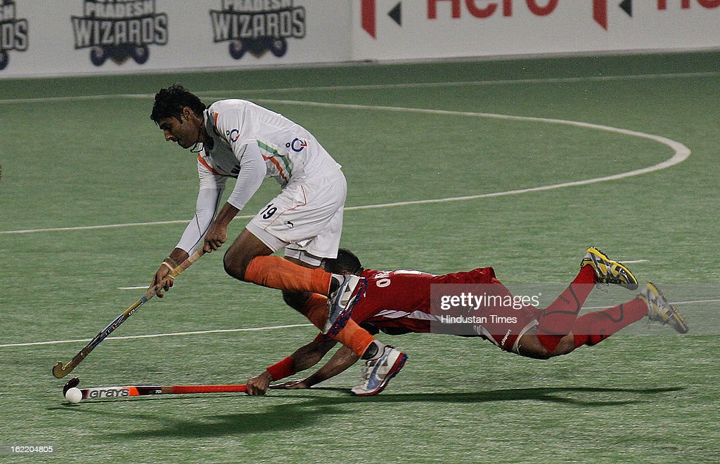 Nithin of India moves past Akram Jamaan of Oman during the Hockey World League round 2 match at Major Dhyan Chand Stadium on February 20, 2013 in New Delhi, India. Indians mauled Oman side by 9-1.