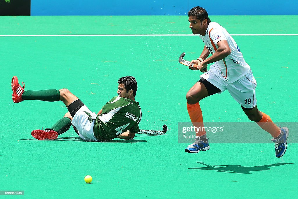 Nithin Thimmaiah of India runs past Muhammad Rizwan of Pakistan in the mens India v Pakistan game during day three of the 2012 International Super Series at Perth Hockey Stadium on November 24, 2012 in Perth, Australia.