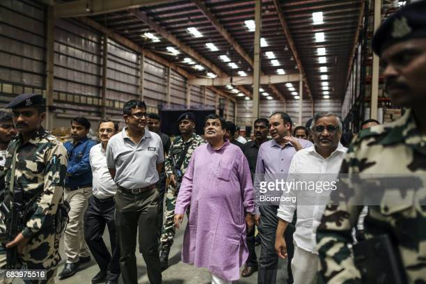 Nitin Gadkari India's road and transport minister center and Kishore Biyani chief executive officer of Future Group second from right attend the...