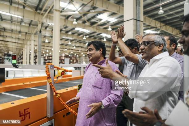 Nitin Gadkari India's road and transport minister left and Kishore Biyani chief executive officer of Future Group second from right attend the...