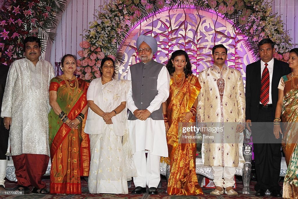 Nitin Gadkari with his wife Kanchan, Shusma Swaraj, Prime Minister Manmohan Singh, Newlywed couple of Sarang and Madhura Gadkari with her parents during their wedding reception on July 2, 2012 in New Delhi, India. BJP president's Nitin Gadkari's younger son Sarang Gadkari tied knot with his classmate Madhura on June 24, 2012 in Nagpur.