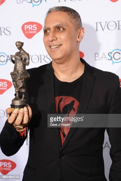 Nitin Sawhney poses in the winners room with the Lifetime Achievement award at the Ivor Novello Awards at Grosvenor House on May 18 2017 in London...