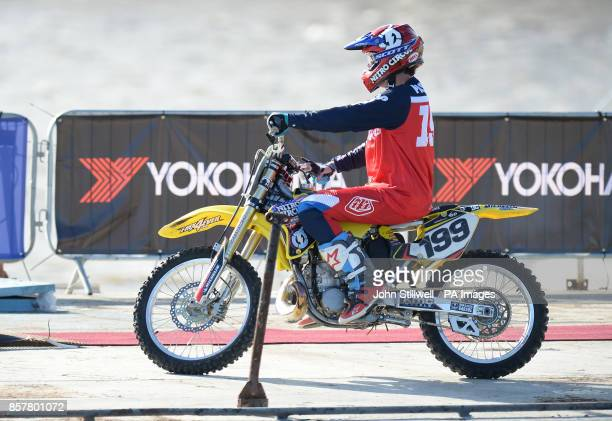 Nitro Circus ringleader and American professional motorsports competitor and stunt rider Travis Pastrana performs backflips on a motorcycle between...
