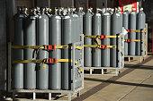 Groups of large Nitrogen gas bottles on stands