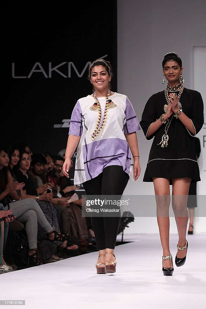 Nitya Arora (L) on the runway during day 2 of Lakme Fashion Week Winter/Festive 2013 at the Hotel Grand Hyatt on August 24, 2013 in Mumbai, India.
