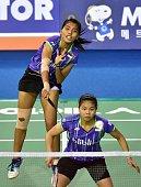 Nitya Krishinda Maheswari and Greysia Polii of Indonesia hit a return against Wang Xiaoli and Yu Yang of China during their women's doubles...
