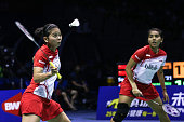 Nitya Krishinda Maheswari and Greysia Polii of Indonesia return to Tang Yuanting and Yu Yang of China during Women's Doubles match in the semifinals...