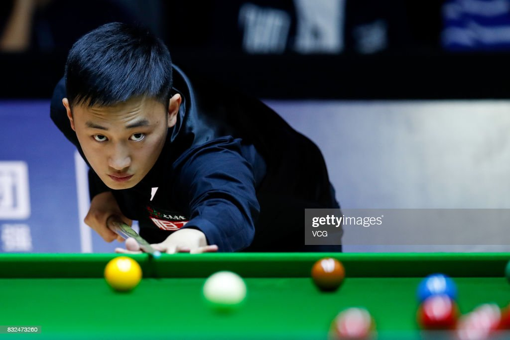 Niu Zhuang of China plays a shot during a qualifying match against Ding Junhui of China on day one of Evergrande 2017 World Snooker China Champion at Guangzhou Sport University on August 16, 2017 in Guangzhou, Guangdong Province of China.