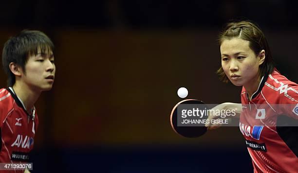 Niwa Koki and Hirano Sayaka of Japan serve during their mixed double match against Mattias Karlsson and Matilda Ekholm of Sweden in the 2015 World...