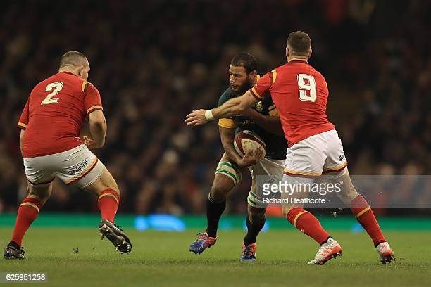 Nizaam Carr of South Africa is tackled by Gareth Davies of Wales during the international match between Wales and South Africa at Principality...
