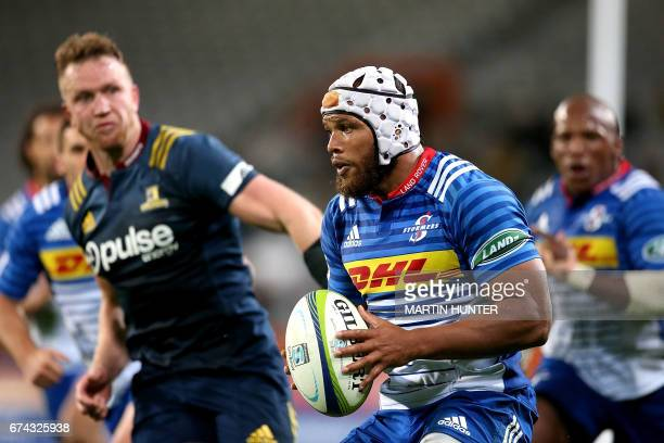 Nizaam Carr of the Western Stormers makes a break with the ball during the Super Rugby match between the Otago Highlanders of New Zealand and the...