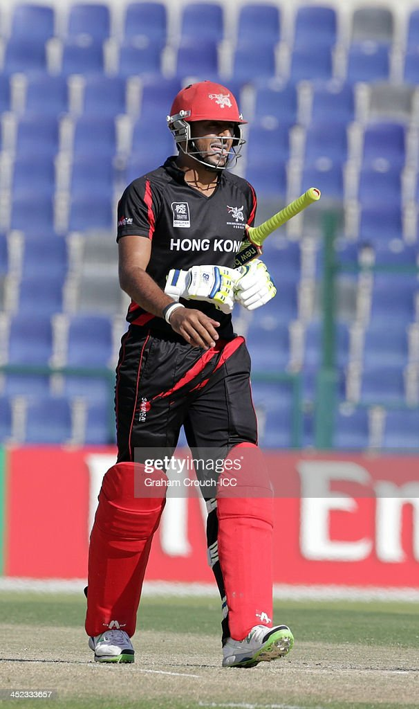 Nizakat Khan of Hong Kong after being dismissed during the Quarter Final match 64 between Papua New Guinea and Hong Kong at the ICC World Twenty20 Qualifiers at the Zayed Cricket Stadium on November 28, 2013 in Abu Dhabi, United Arab Emirates.