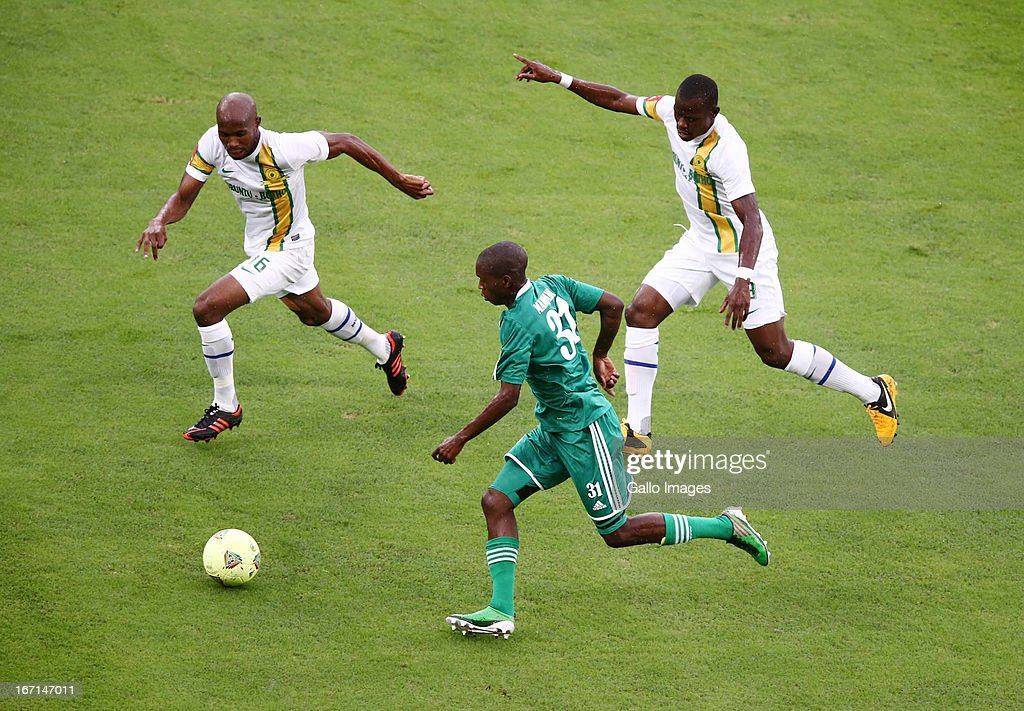 Njabulo Manqana of AmaZulu (C) takes on the Sundowns defence during the Absa Premiership match between AmaZulu and Mamelodi Sundowns at Moses Mabhida Stadium on April 21, 2013 in Durban, South Africa.