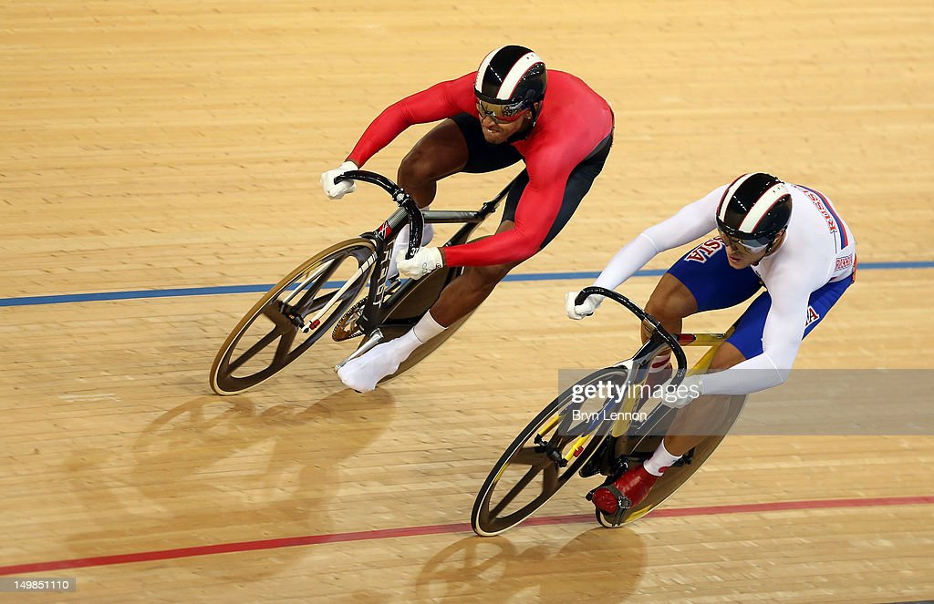 Njisane Nicholas Phillip (L) of Trinidad and Tobago competes against <a gi-track='captionPersonalityLinkClicked' href=/galleries/search?phrase=Denis+Dmitriev&family=editorial&specificpeople=5492378 ng-click='$event.stopPropagation()'>Denis Dmitriev</a> of Russia during the Men's Sprint Track Cycling Quarterfinals on Day 9 of the London 2012 Olympic Games at Velodrome on August 5, 2012 in London, England.