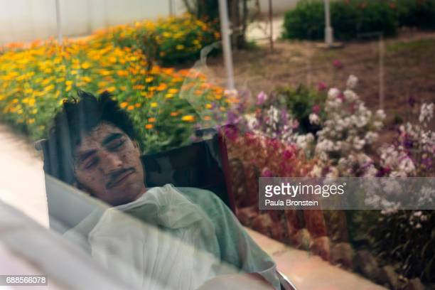 'nKharim Ahmad suffered shrapnel wounds on his face and the loss of a leg from fighting in Sangin He was being treated at the Emergency hospital in...