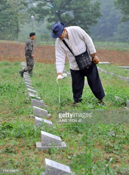 NKoreaSKoreaanniversarywarhistorycemeteryFEATURE by LIM ChangWon This picture taken on May 29 2013 shows South Korean Buddhist monk Mukgai pouring...
