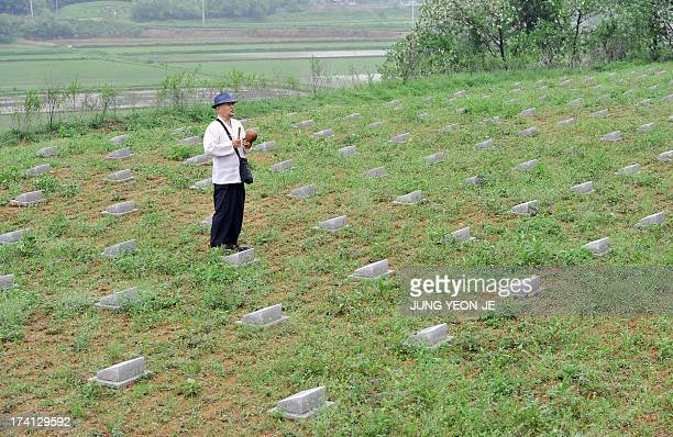 NKoreaSKoreaanniversarywarhistorycemeteryFEATURE by LIM ChangWon This picture taken on May 29 2013 shows South Korean Buddhist monk Mukgai beating a...