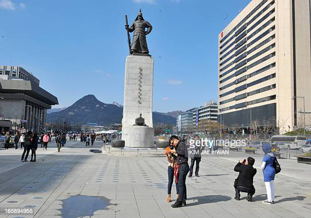 NKoreaSKoreaUSmilitarysocietyFOCUS by Giles Hewitt Tourists take photos in front of the landmark statue of Lee SoonShin the venerated war hero in the...