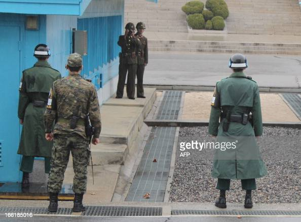 NKoreaSKoreaUSmilitarytourismFOCUS by Ruby Tam South Korean soldiers stand guard at the tense border truce village of Panmunjom in the demilitarised...