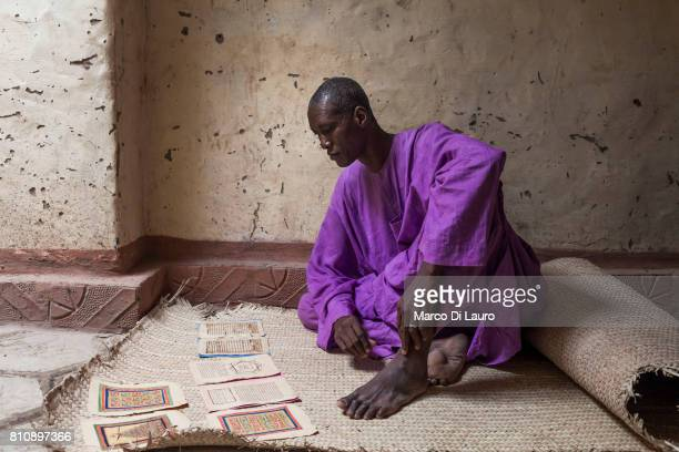 'nMalian manuscript expert and librarian Dramane Moulaye Haidara 50yearsold is seen consulting an ancient manuscript at his house on August 10 2013...