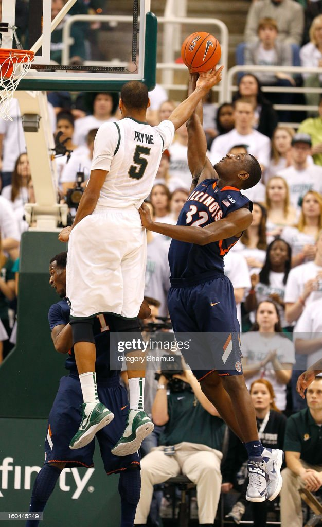 Nnanna Egwu #32 of the Illinois Fighting Illini blocks a second half shot by Adreian Payne #5 of the Michigan State Spartans at the Jack T. Breslin Student Events Center on January 31, 2013 in East Lansing, Michigan. Michigan State won the game 80-75.
