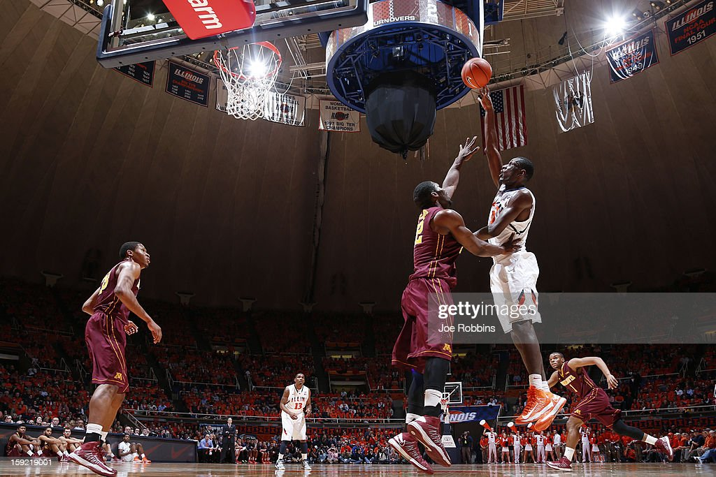 Nnanna Egwu #32 of the Illinois Fighting Illini goes to the basket against <a gi-track='captionPersonalityLinkClicked' href=/galleries/search?phrase=Trevor+Mbakwe&family=editorial&specificpeople=4898343 ng-click='$event.stopPropagation()'>Trevor Mbakwe</a> #32 of the Minnesota Golden Gophers during the game at Assembly Hall on January 9, 2013 in Champaign, Illinois. Minnesota won 84-67.