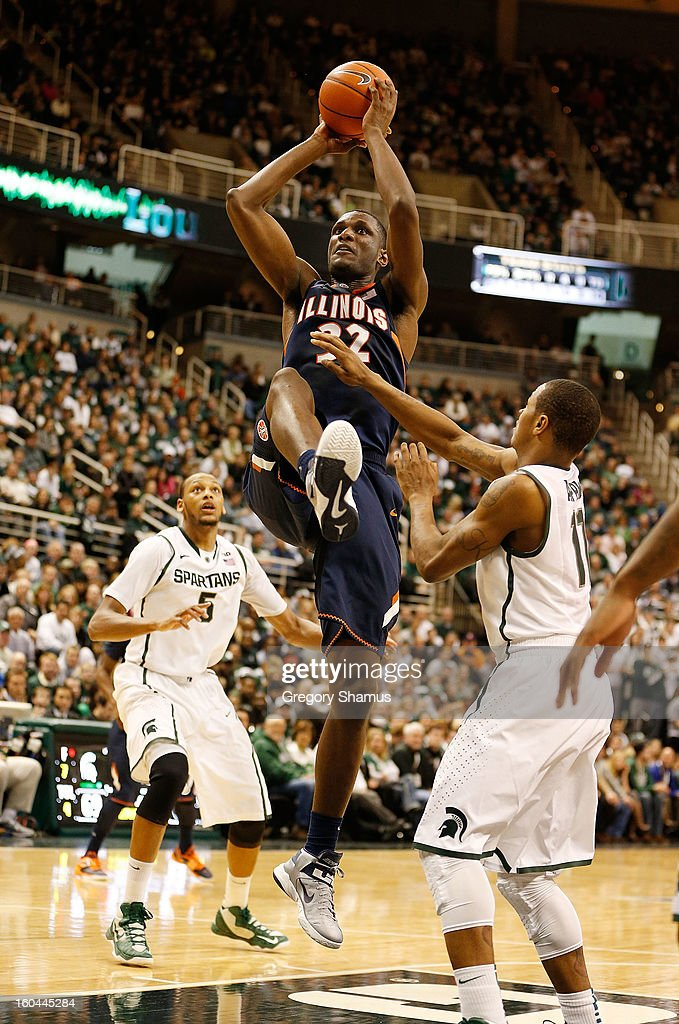 Nnanna Egwu #32 of the Illinois Fighting Illini grabs a second half rebound next to Keith Appling #11 of the Michigan State Spartans at the Jack T. Breslin Student Events Center on January 31, 2013 in East Lansing, Michigan. Michigan State won the game 80-75.