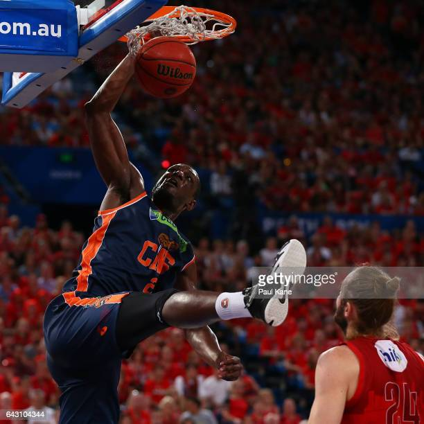 Nnanna Egwu of the Taipans dunks the ball during the game two NBL Semi Final match between the Perth Wildcats and Cairns Taipans at Perth Arena on...