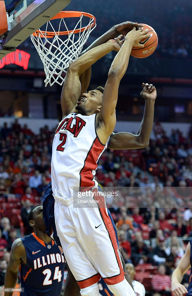 Nnannu Egwu (behind) #32 of the Illinois Fighting Illini blocks a shot by Khem Birch #2 of the UNLV Rebels during their game at the Thomas & Mack Center on November 26, 2013 in Las Vegas, Nevada. Illinois won 61-59.