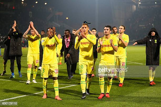Nnates' players celebrate with their fans during the French Ligue 1 match between Angers and Nantes on December 16 2016 in Angers France