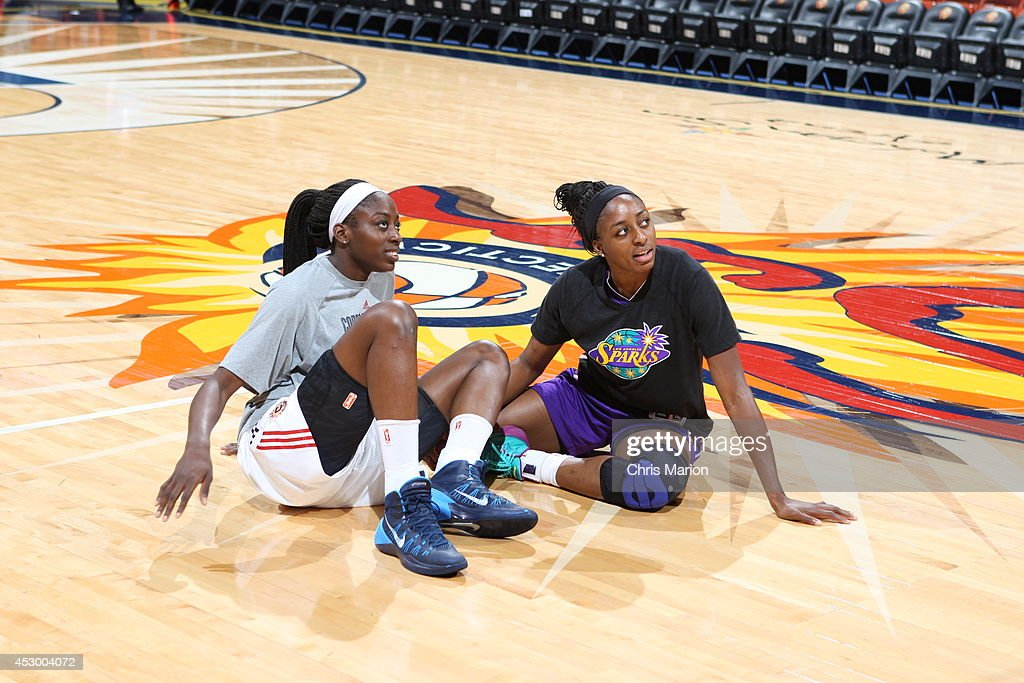 Nneka Ogwumike #30 of the Los Angeles Sparks and Chiney Ogwumike #13 of the Connecticut Sun prior to a game at the Mohegan Sun Arena on July 13, 2014 in Uncasville, Connecticut.