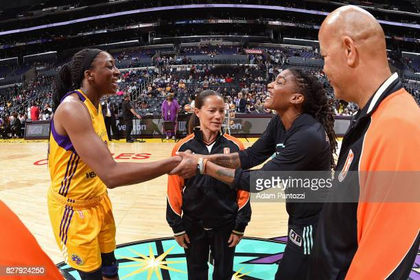 Nneka Ogwumike of the Los Angeles Sparks and Shavonte Zellous of the New York Liberty shake hands next to referees Daryl Humphrey and Maj Forsberg...