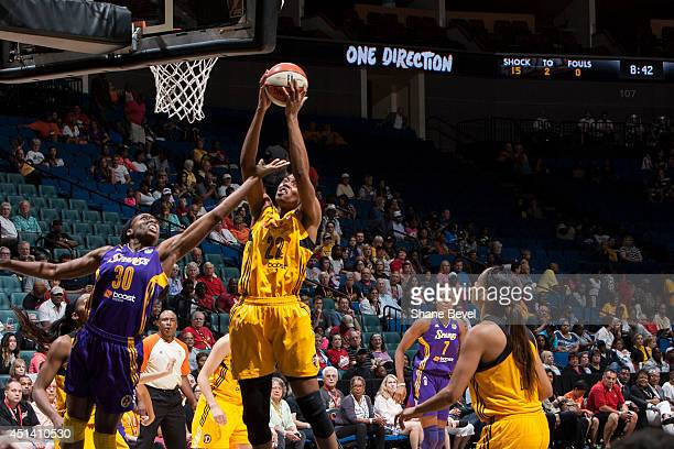 Nneka Ogwumike of the Los Angeles Sparks battles for a rebound against Vicki Baugh of the Tulsa Shock during the WNBA game on June 28 2014 at the BOK...