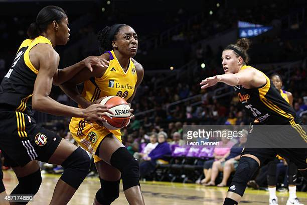 Nneka Ogwumike of the Los Angeles Sparks goes to the basket against Vicki Baugh and Jordan Hooper of the Tulsa Shock in a WNBA game at Staples Center...
