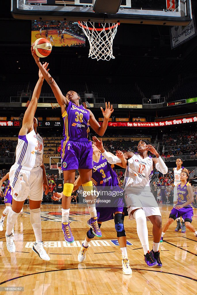 Nneka Ogwumike #30 of the Los Angeles Sparks grabs a rebound against Krystal Thomas #34 of the Phoenix Mercury in Game 2 Round 1 of the 2013 WNBA Playoffs on September 13, 2013 at U.S. Airways Center in Phoenix, Arizona.