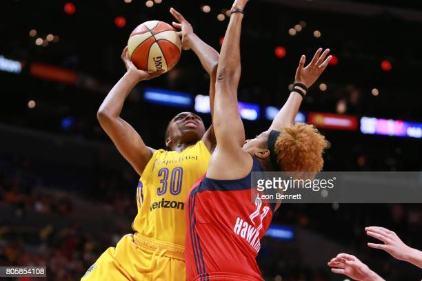 Nneka Ogwumike of the Los Angeles Sparks handles the ball against Tianna Hawkins of the Washington Mystics during a WNBA basketball game at Staples...