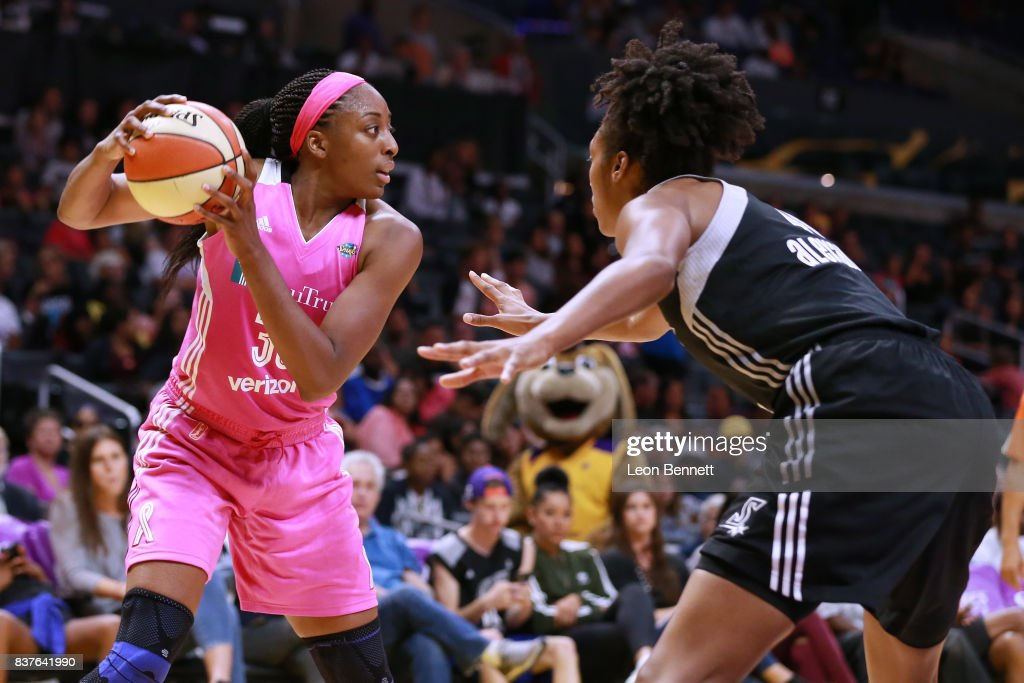 Nneka Ogwumike #30 of the Los Angeles Sparks handles the ball against Kayla Alexander #40 of the San Antonio Stars during a WNBA game at Staples Center on August 22, 2017 in Los Angeles, California.