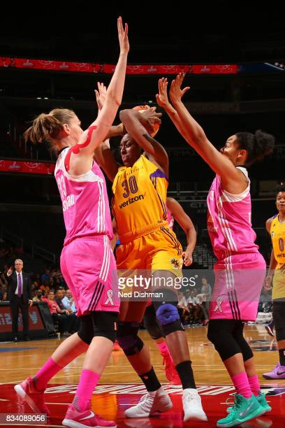 Nneka Ogwumike of the Los Angeles Sparks handles the ball during the game against the Washington Mystics on August 16 2017 at the Verizon Center in...