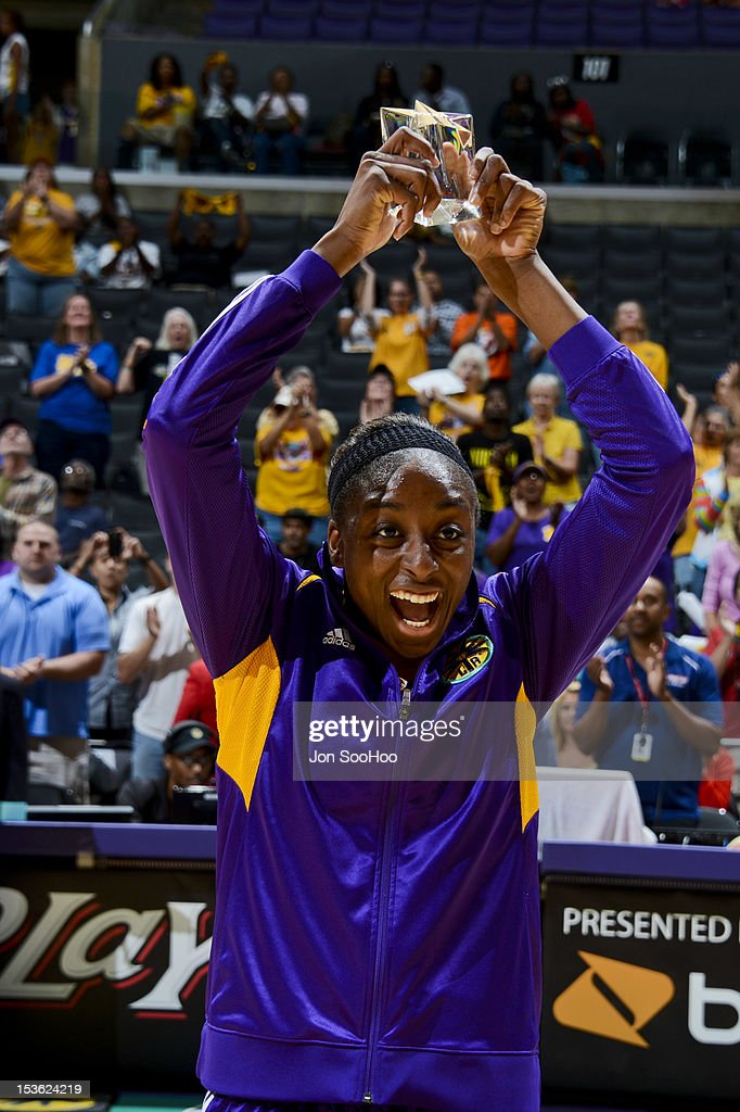 Nneka Ogwumike #30 of the Los Angeles Sparks holds up her award for Rookie of the Year prior to Game Two of the WNBA Western Conference Finals against the Minnesota Lynx at Staples Center on October 7, 2012 in Los Angeles, California.