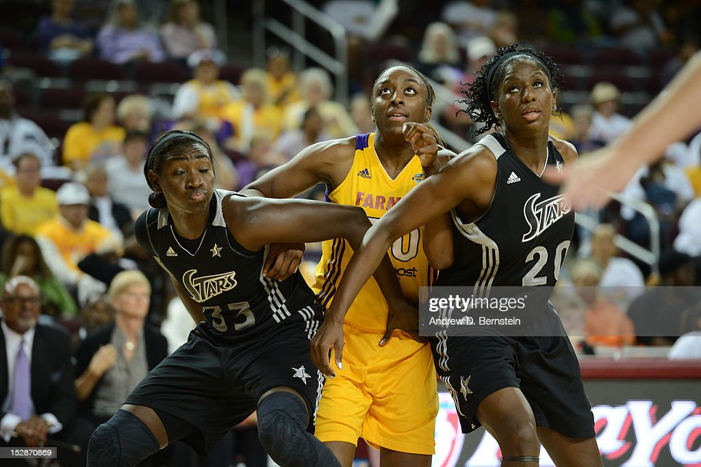 Nneka Ogwumike #30 of the Los Angeles Sparks is boxed out by <a gi-track='captionPersonalityLinkClicked' href=/galleries/search?phrase=Sophia+Young&family=editorial&specificpeople=541422 ng-click='$event.stopPropagation()'>Sophia Young</a> #33 and <a gi-track='captionPersonalityLinkClicked' href=/galleries/search?phrase=Shameka+Christon&family=editorial&specificpeople=220661 ng-click='$event.stopPropagation()'>Shameka Christon</a> #20 of the San Antonio Stars during Game 1 of the WNBA Western Conference Semi Finals at Galen Center on September 27, 2012 in Los Angeles, California.