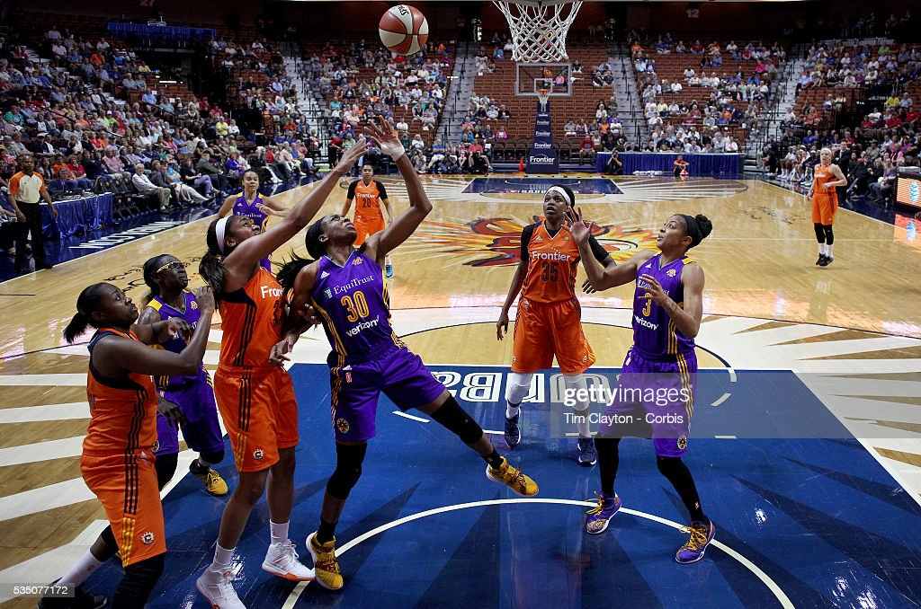 Nneka Ogwumike #30 of the Los Angeles Sparks rebounds while challenged by Morgan Tuck #33 of the Connecticut Sun during the Los Angeles Sparks Vs Connecticut Sun, WNBA regular season game at Mohegan Sun Arena on May 26, 2016 in Uncasville, Connecticut.
