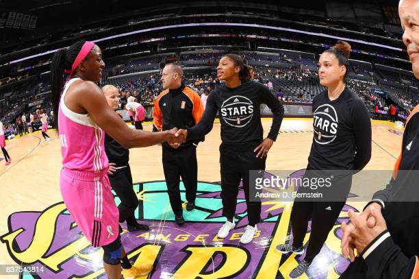 Nneka Ogwumike of the Los Angeles Sparks shakes hands with Alex Montgomery of the San Antonio Stars before the game on August 22 2017 at the STAPLES...