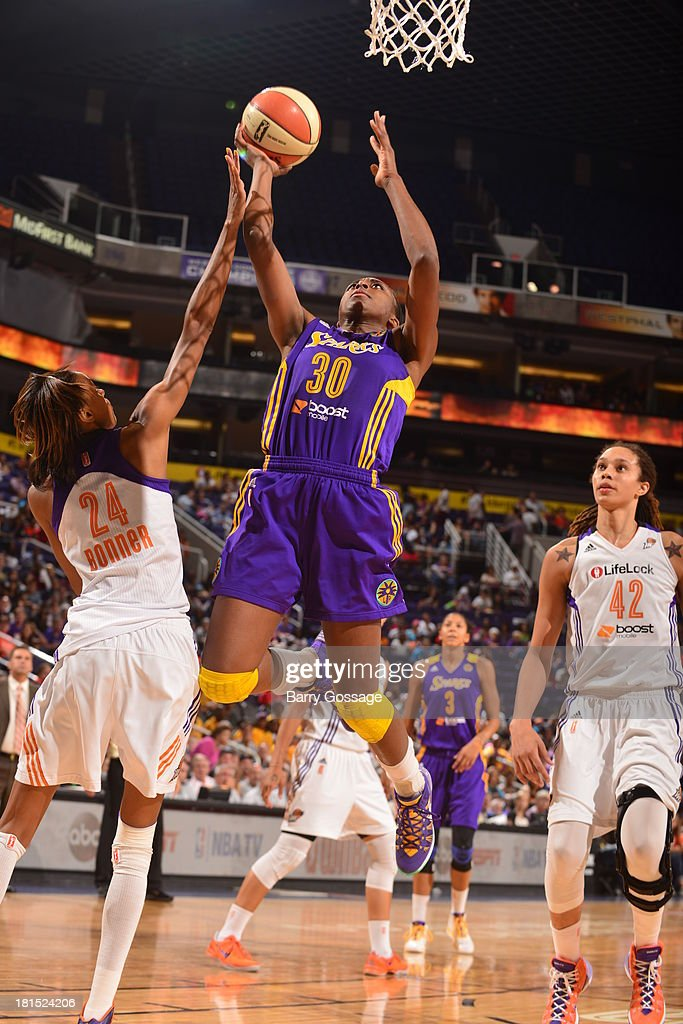 Nneka Ogwumike #30 of the Los Angeles Sparks shoots against <a gi-track='captionPersonalityLinkClicked' href=/galleries/search?phrase=DeWanna+Bonner&family=editorial&specificpeople=4085058 ng-click='$event.stopPropagation()'>DeWanna Bonner</a> #24 of the Phoenix Mercury in Game 2 Round 1 of the 2013 WNBA Playoffs on September 13, 2013 at U.S. Airways Center in Phoenix, Arizona.