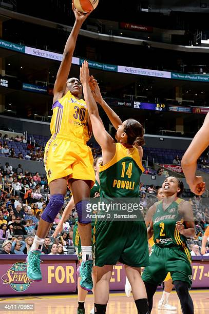 Nneka Ogwumike of the Los Angeles Sparks shoots against Nicole Powell of the Seattle Storm at STAPLES Center on June 24 2014 in Los Angeles...